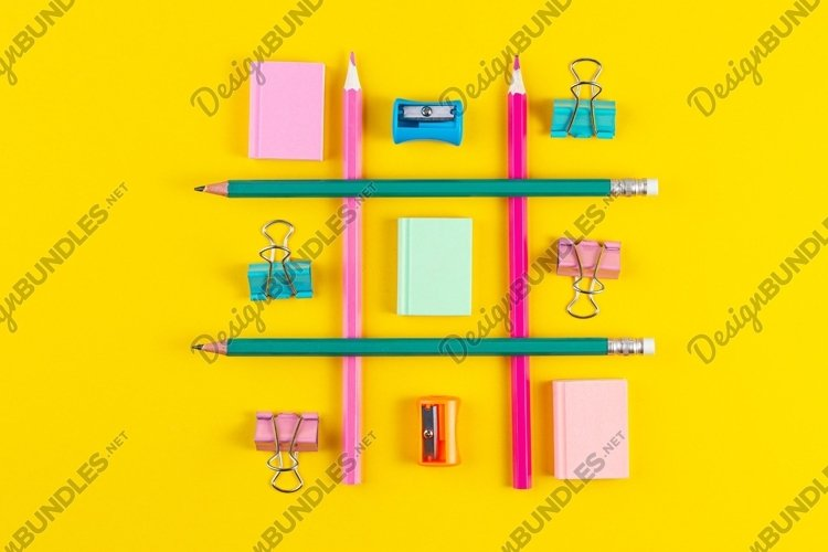 School pencils on yellow background with School supplies. example image 1