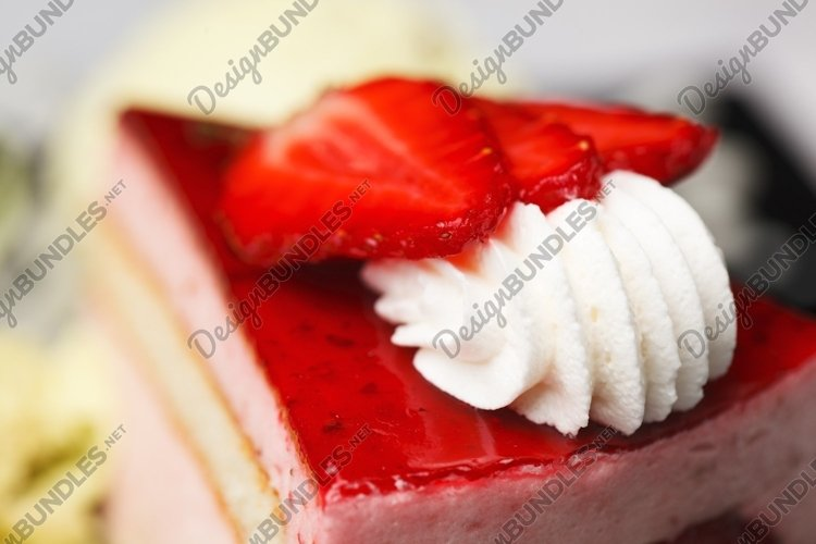 Whirl of whipped cream topping on a cake example image 1