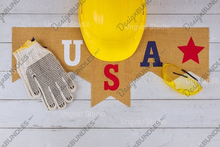 Symbol celebrating Labor Day is a federal holiday equipment example image 1