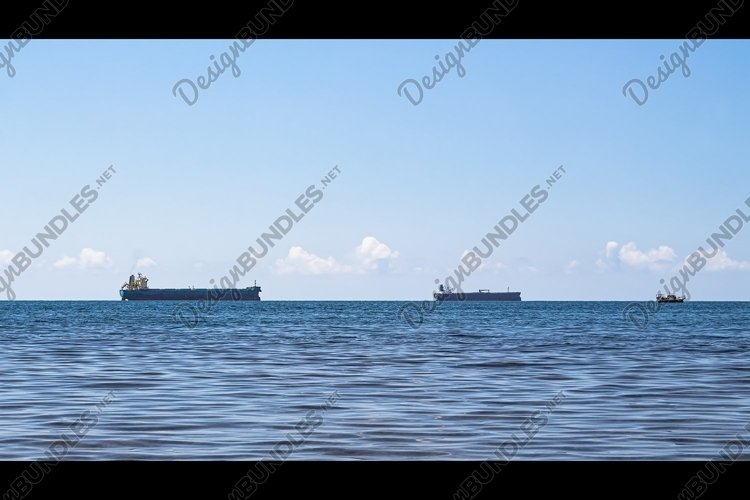 Close-up of the seascape. Blue sea and cargo ships. 3pcs example image 1