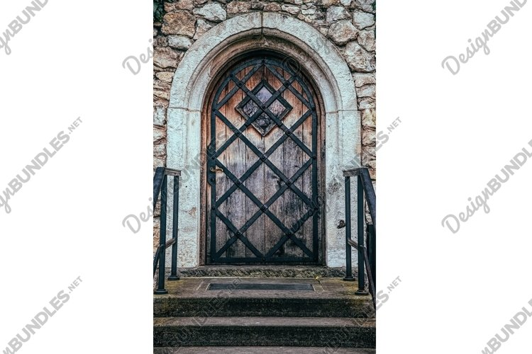 Antique wrought iron door and brick wall example image 1