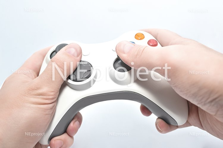 gamepad in the players hands isolated on white background