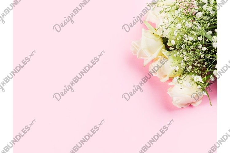 White roses flowers bouquet on pastel pink background.