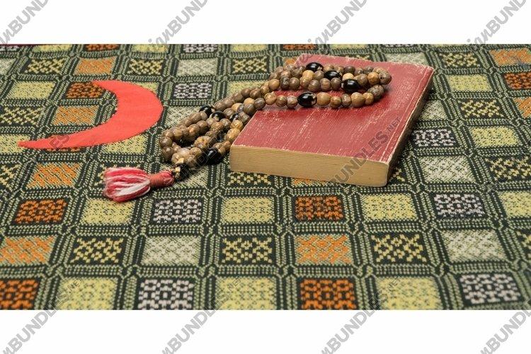 Muslim prayer beads and Quran on the prayer Mat. Ramadan example image 1