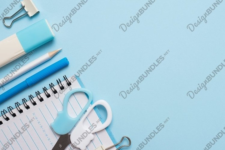 Pastel blue stationery on blue background with a copy space example image 1