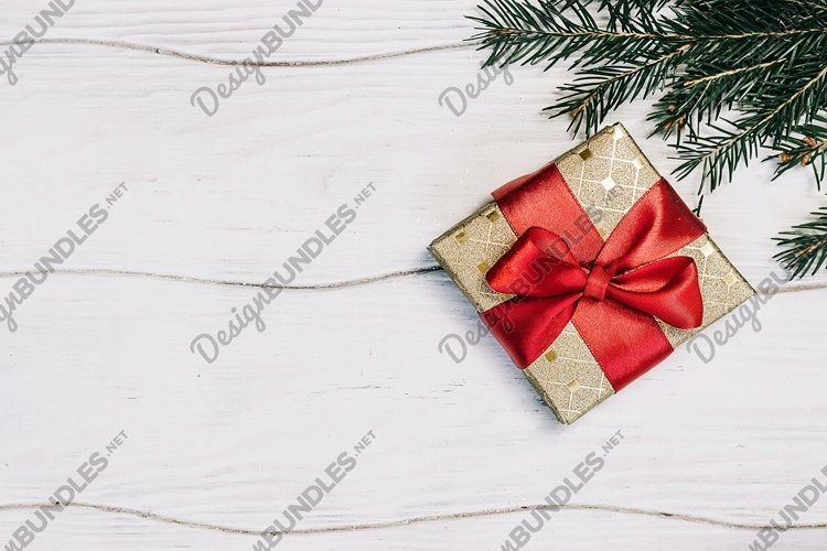 Christmas or New Year gift box with red ribbon