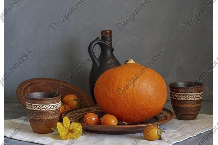 Autumn still life with pumpkin and nasturtium flowers. example image 1