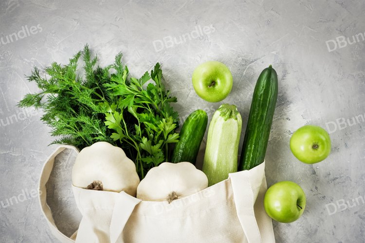 Fresh vegetables and fruits, greenery in a reusable bag