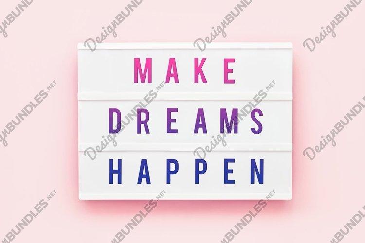 MAKE DREAMS HAPPEN written in light box