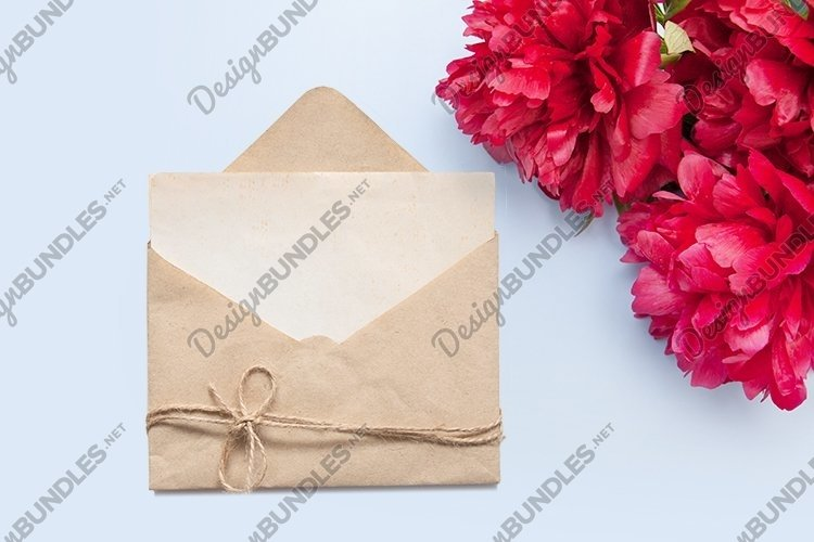 Mock up paper in envelope with peonies top view example image 1