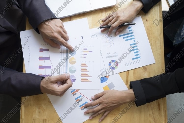 Business people meeting to discuss the situation. example image 1