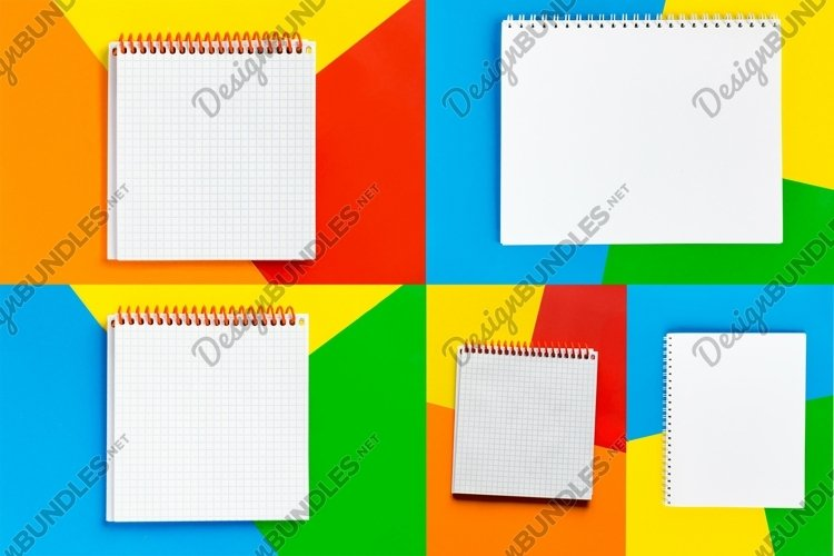 Flatlay of notepad with copy space on colorful background