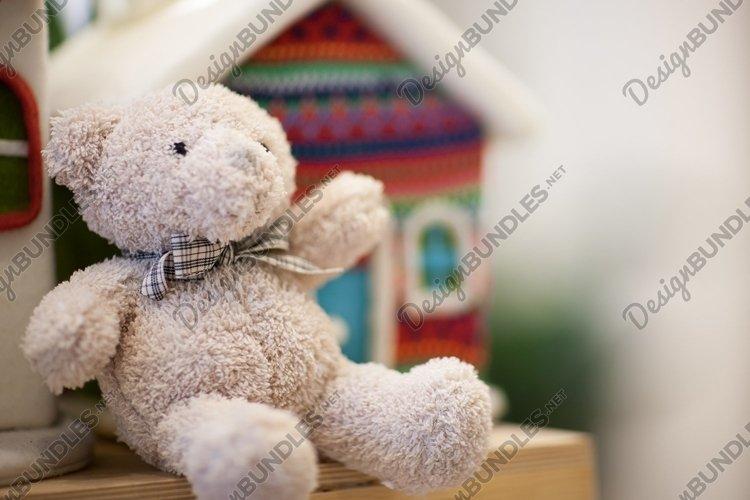 Soft white teddy bear on the shelf. New Year decoration example image 1