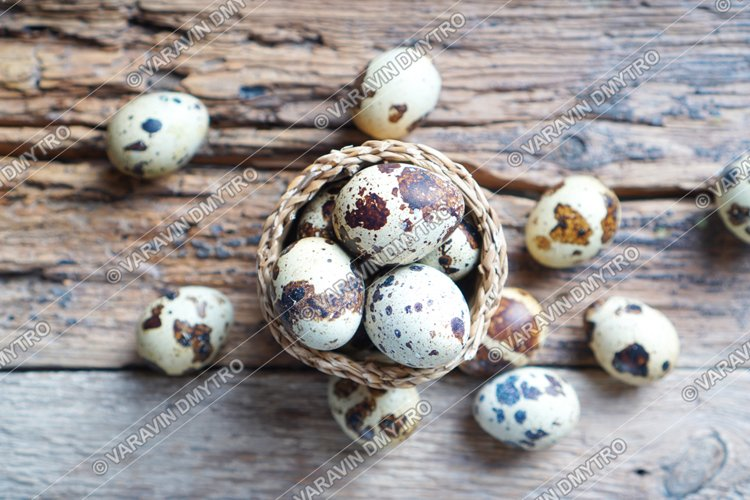 Quail eggs in a little wicker basket example image 1