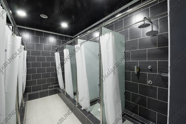 Public shower room with curtains in a sports complex example image 1