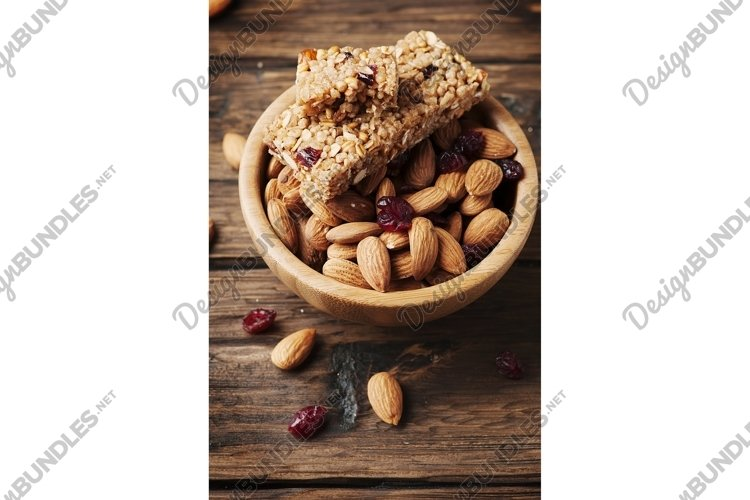 Cereal bar with almond and berry on the wooden table example image 1