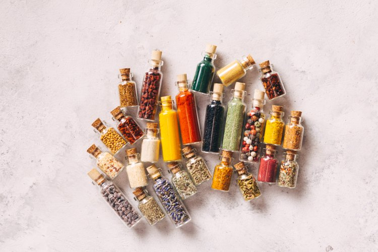 Assorted ground spices in vintage bottles example image 1