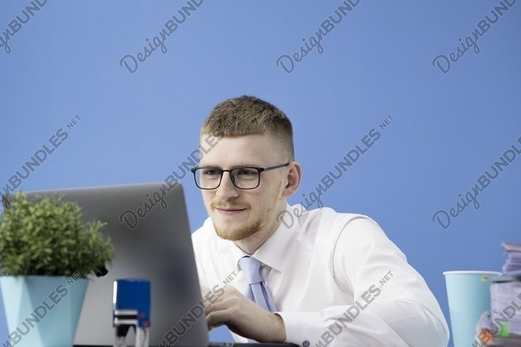 Handsome man dressed in classic shirt with blue tie example image 1