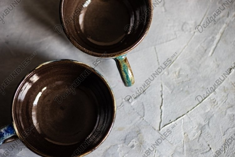 Handmade mugs on rustic background example image 1