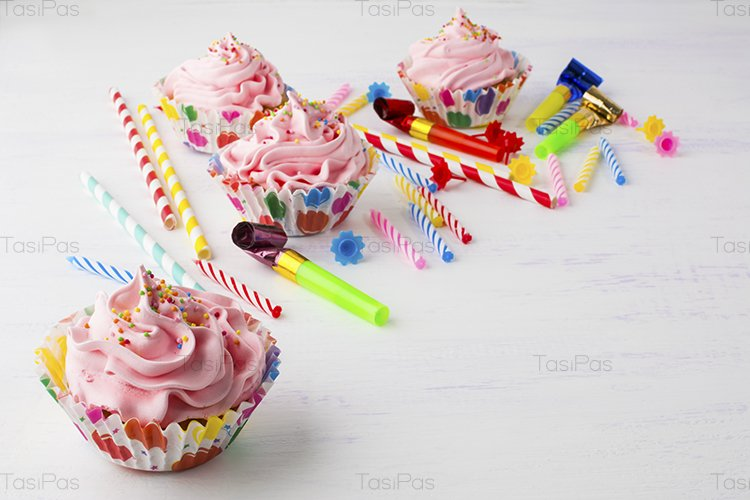 Pink cupcakes and candles birthday background example image 1