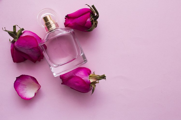 perfume and rosebud, on a pink background with
