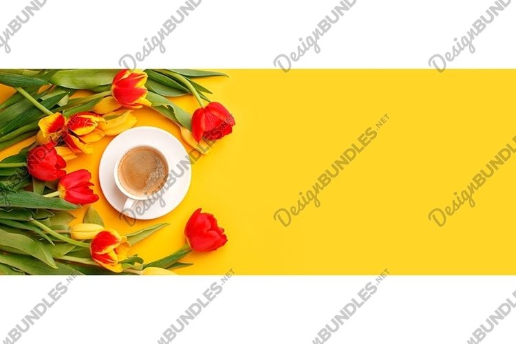 Bouquet of red yellow tulips and coffee cup on bright yellow