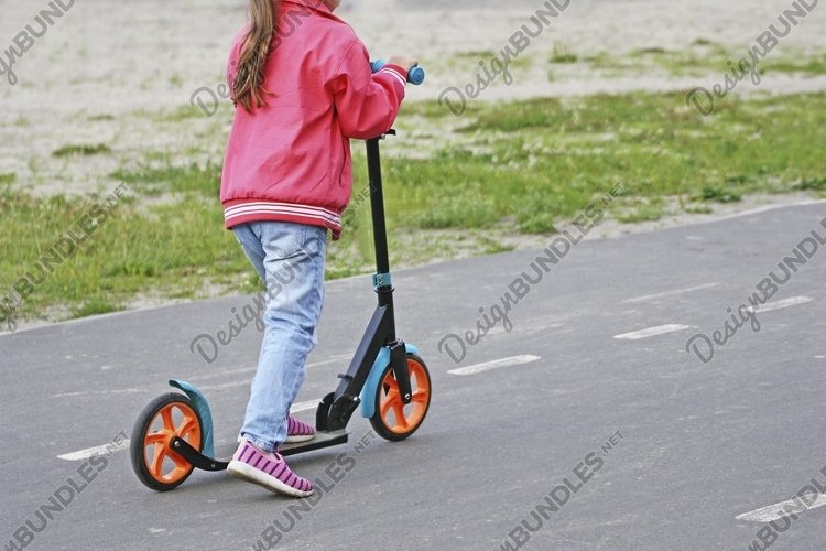 Girl rides a scooter example image 1