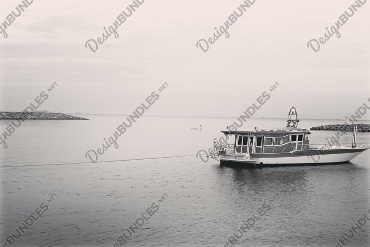 Lonely fishing boat in a Thai harbour, black and white photo