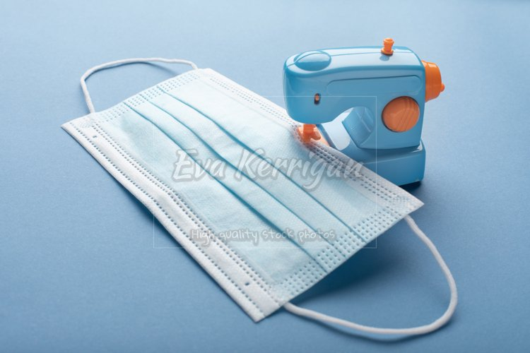 Toy sewing machine sews medical surgical protective mask. example image 1