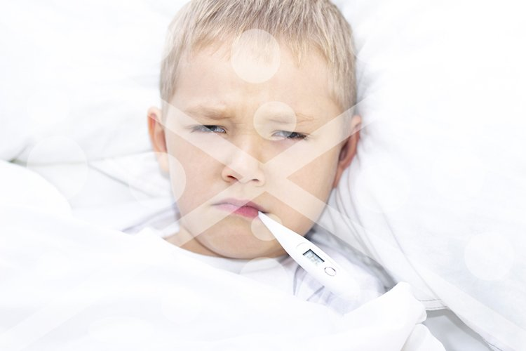 boy lies in bed with a thermometer in his mouth. healthcare example image 1