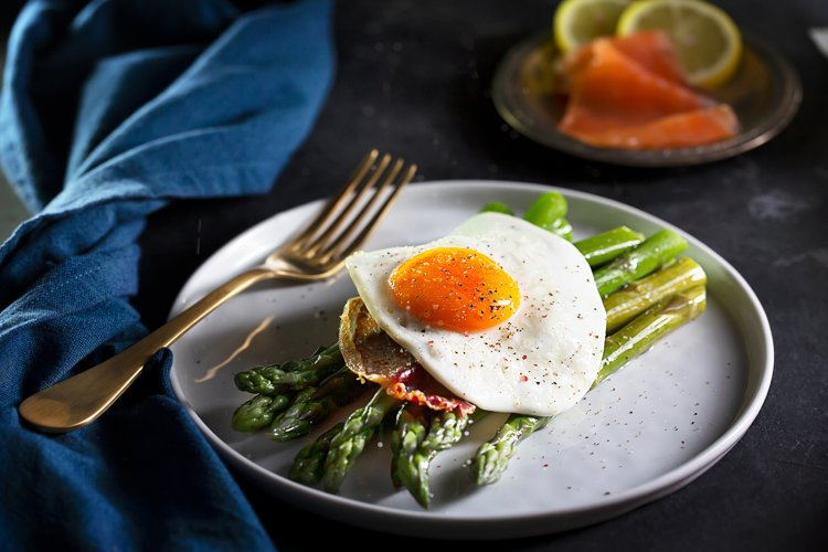 Fried eggs with asparagus, dark moody style example image 1