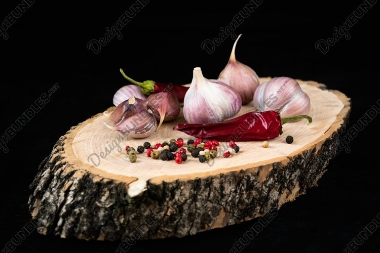 Garlic, chili and colorful peppercorns on wooden background example image 1