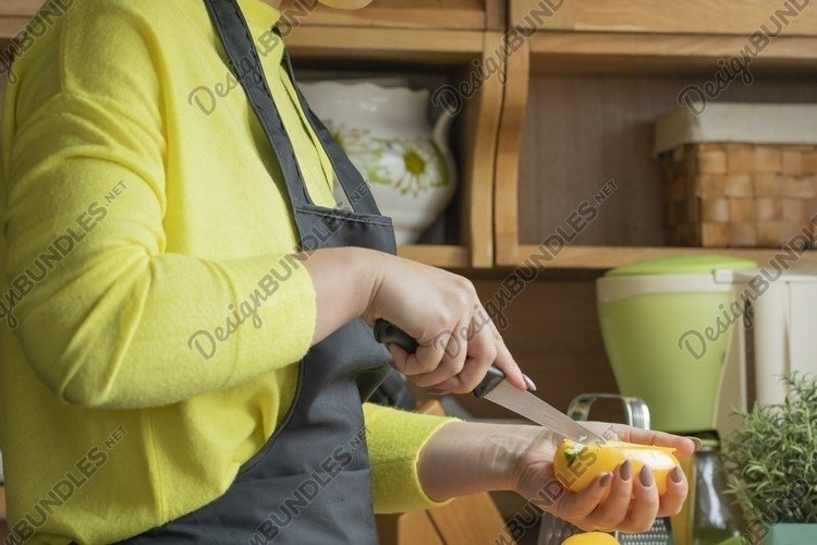 Pretty young girl in black apron in kitchen example image 1