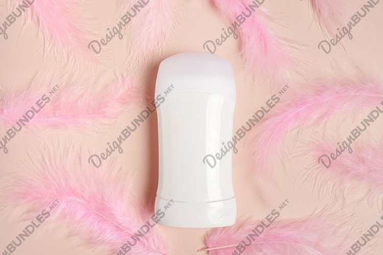 Deodorant with feathers on pink background example image 1