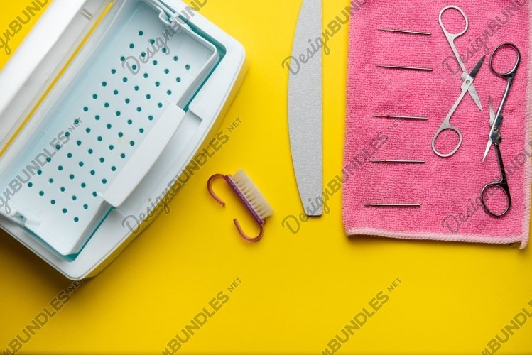 Top view of manicure equipment on yellow background example image 1