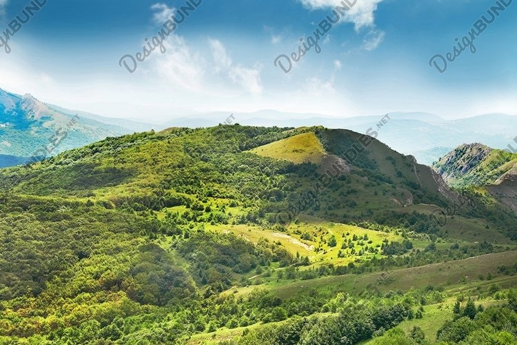 Green mountain covered with forest on the blue sky example image 1