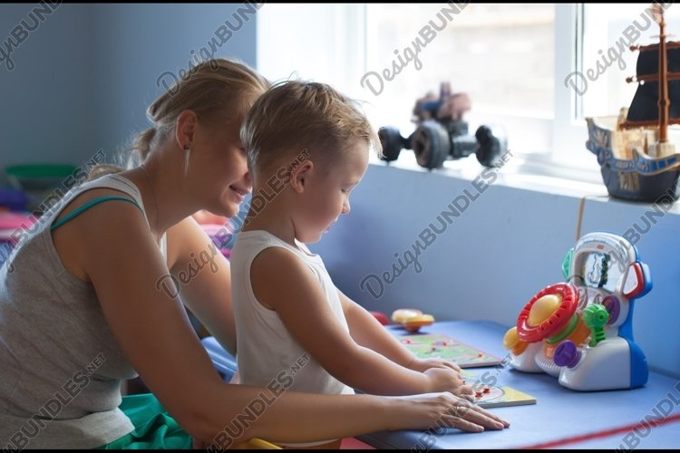 Mother playing learning game with son example image 1