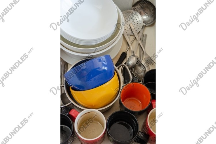 Dirty dishes in ceramic kitchen sink. Unwashed plates, mugs example image 1