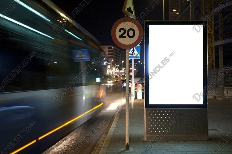 mock up of a billboard on a night street. example image 1