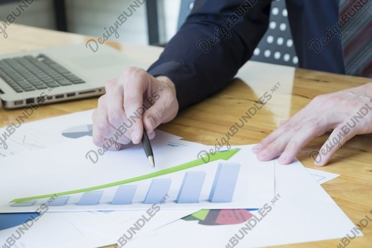 Hand of businessman point the marketing chart. example image 1