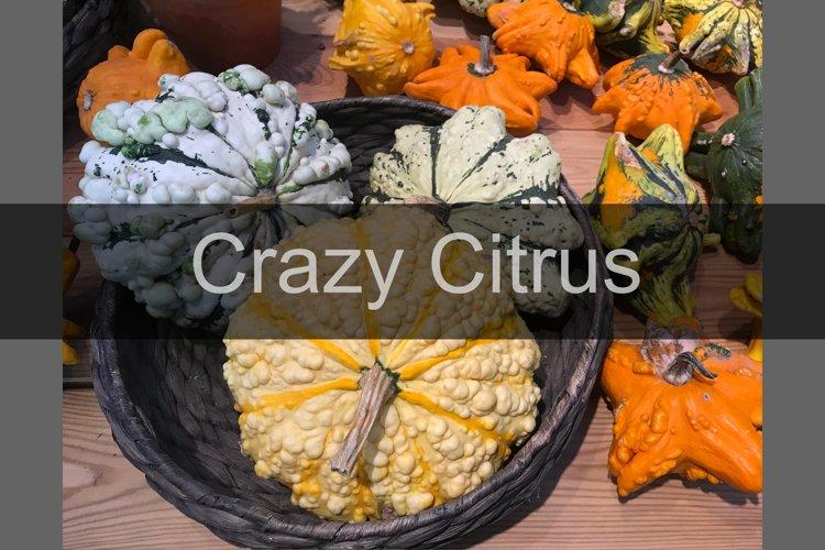 Halloween yellow, orange, green pumpkins in basket on table