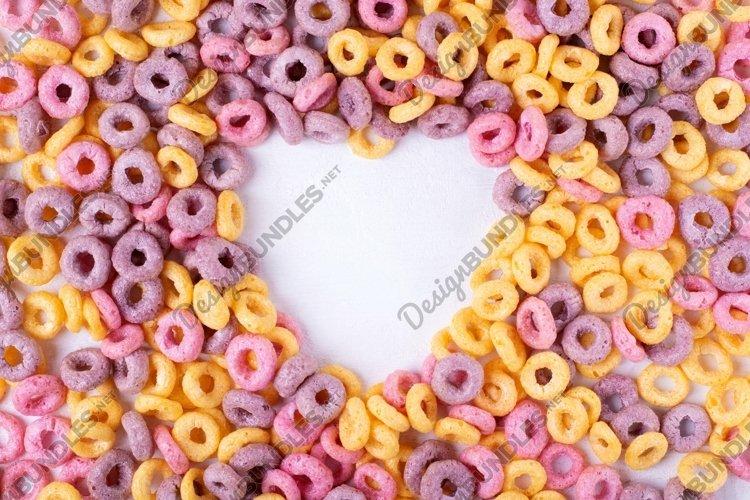 Breakfast cereal loops framing copy space