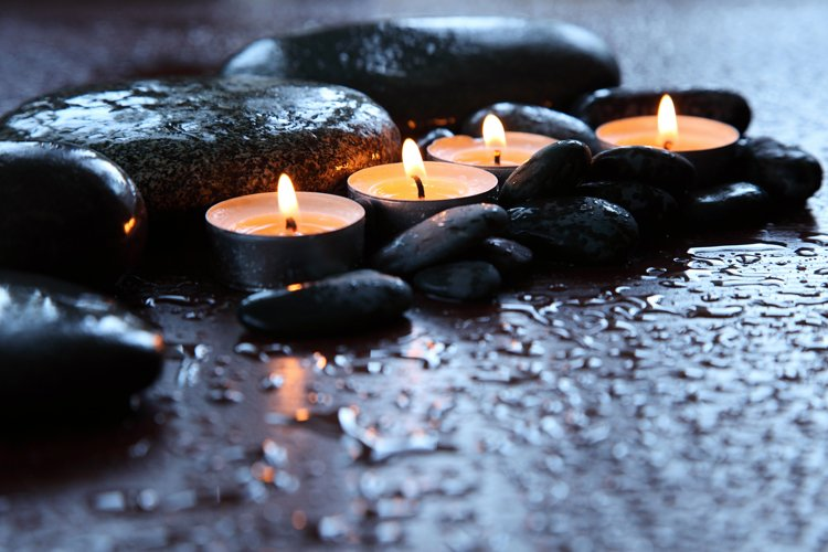 Burning candles and drops of water. Stone therapy. example image 1