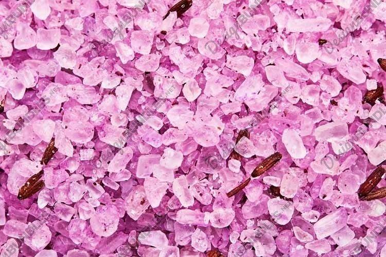 Pink sea salt background. SPA concept.
