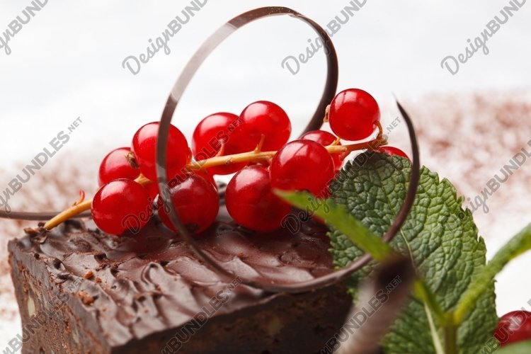 Chocolate cake with red currant example image 1