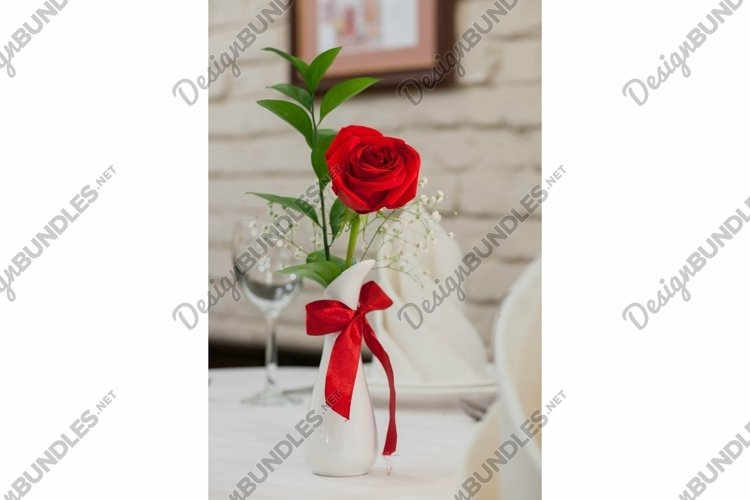 Rose flowers in a vase on a celebratory table example image 1