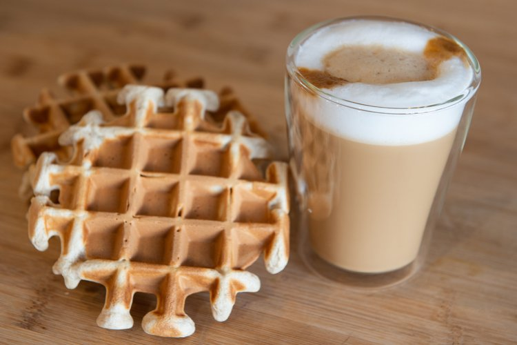 multilayer coffee or cappuccino in a glass cup
