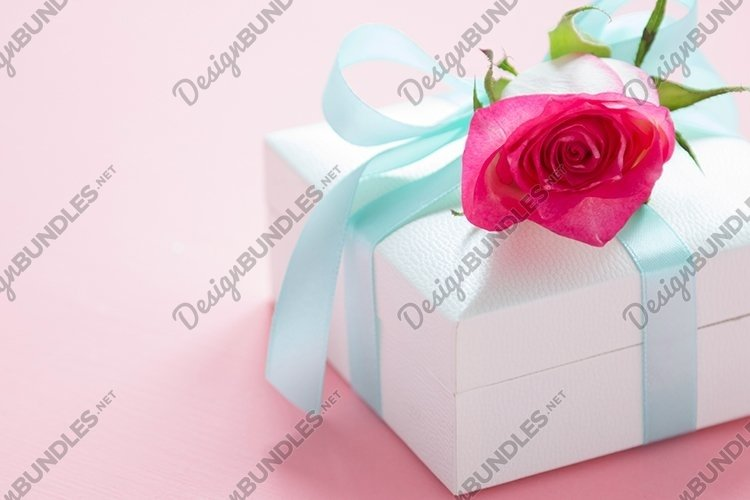 Gift box and rose.