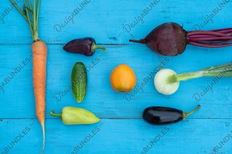 Fresh vegetables on the blue, wooden background example image 1