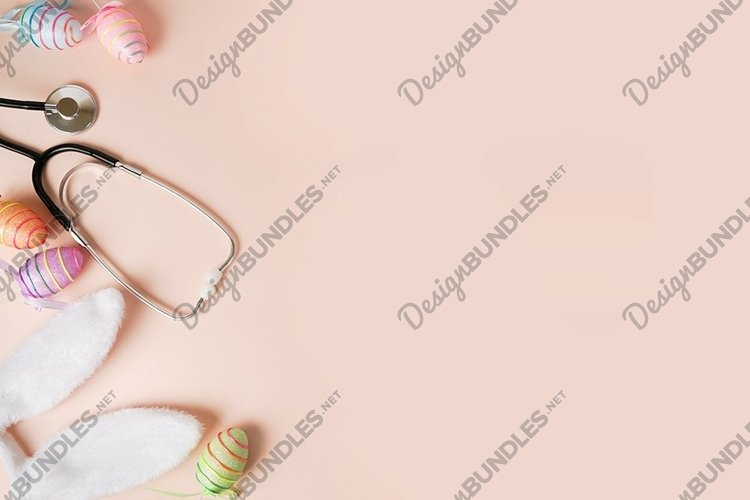 Stethoscope and easter eggs, bunny ears on pink background example image 1